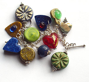 charm bracelet with polymer clay charms and glass beads