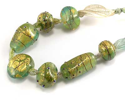 green and gold lampwork beads by emma ralph